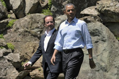France's President Francois Hollande (L) and U.S. President Barack Obama walk to the family photo session at the G8 summit at Camp David, Ma