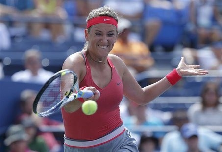 Victoria Azarenka of Belarus hits a return to Alize Cornet of France at the U.S. Open tennis championships in New York August 31, 2013. REUT