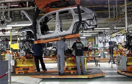 Chrysler Group assembly workers lower the frame onto the chassis for Chrysler Jeeps, Grand Cherokees and Dodge Durangos at the Chrysler Jefferson North auto plant in Detroit, Michigan April 28, 2011.  Credit: Reuters/Rebecca Cook
