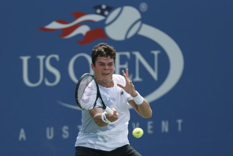 Milos Raonic of Canada hits a return to Feliciano Lopez of Spain at the U.S. Open tennis championships in New York August 31, 2013. REUTERS/