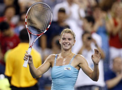 Camila Giorgi of Italy celebrates defeating Caroline Wozniacki of Denmark at the U.S. Open tennis championships in New York August 31, 2013.