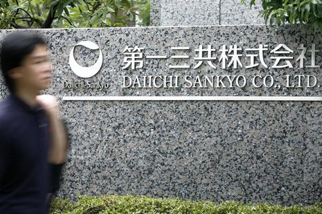 A man walks past a sign of Japanese pharmaceutical company Daiichi Sankyo Co., Ltd. at the company's head office in Tokyo July 17, 2009. REU