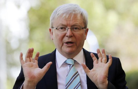 Australian Prime Minister Kevin Rudd gestures as he talks to parents at the Mascot Early Childhood Centre as part of his election campaign i