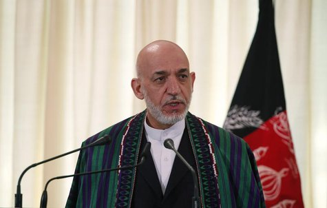 Afghan President Hamid Karzai speaks during a joint news conference with Pakistan's Prime Minister Nawaz Sharif (not pictured) at the prime