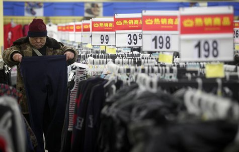 A customer selects trousers at a supermarket in Wuhan, Hubei province February 9, 2012. REUTERS/Stringer