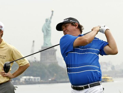 Jason Dufner of the U.S. tees off on the 15th hole during the first round of the Barclays PGA golf tournament in Jersey City, New Jersey Aug