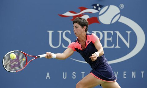 Carla Suarez Navarro of Spain hits a return to Angelique Kerber of Germany at the U.S. Open tennis championships in New York September 1, 20