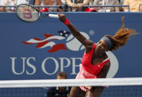 Serena Williams of the U.S. serves to compatriot Sloane Stephens at the U.S. Open tennis championships in New York September 1, 2013. REUTER