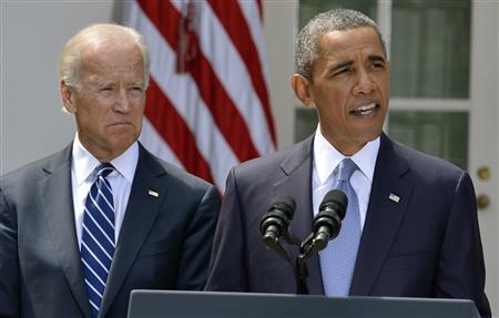 U.S. President Barack Obama speaks about Syria next to Vice President Joe Biden (L) at the Rose Garden of the White House August 31, 2013, in Washington.  Credit: REUTERS/Mike Theiler
