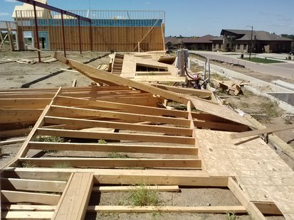 The frame walls of a business under construction near the corner of 62nd and Western were blown over by Saturday's high winds. (KELO AM Photo)