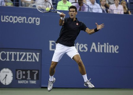 Novak Djokovic of Serbia returns a forehand to Joao Sousa of Portugal at the U.S. Open tennis championships in New York, September 1, 2013.