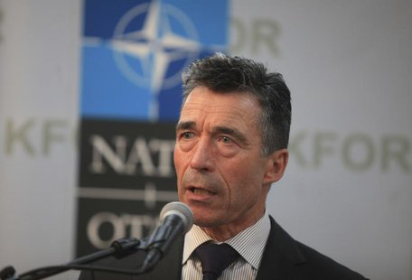 NATO Secretary-General Anders Fogh Rasmussen speaks during a joint news conference with Kosovo's Prime Minister Hashim Thaci in Pristina Jul
