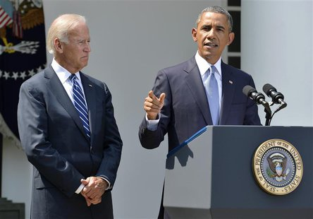 U.S. President Barack Obama speaks next to Vice President Joe Biden (L) at the Rose Garden of the White House August 31, 2013, in Washington