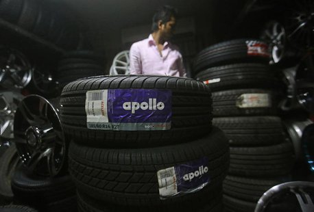An employee works inside a showroom selling Apollo tyres in Mumbai June 13, 2013. REUTERS/Danish Siddiqui