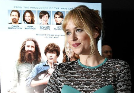 "Cast member Dakota Johnson poses at the premiere of ""Goats"" at the Landmark theatre in Los Angeles, California August 8, 2012. REUTERS/Mario"