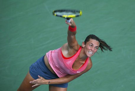 Roberta Vinci of Italy serves to compatriot Camila Giorgi at the U.S. Open tennis championships in New York September 2, 2013. REUTERS/Kena
