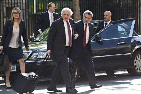 Rajat Gupta (front R), a former Goldman Sachs Group Inc and Procter & Gamble board member, arrives at Manhattan Federal Court in New York, i