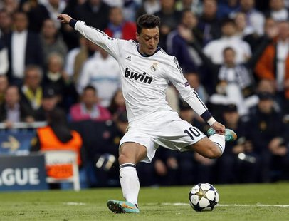 Real Madrid's Mesut Ozil shoots towards the goal of Borussia Dortmund during their Champions League semi-final second leg soccer match at Sa