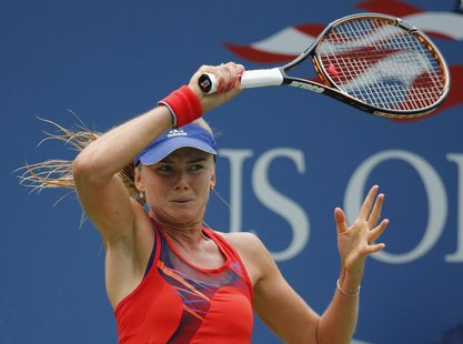 Daniela Hantuchova of Slovakia returns to Alison Riske of the U.S. at the U.S. Open tennis championships in New York September 2, 2013. REUT