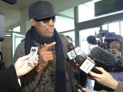Former NBA star Dennis Rodman speaks to media just before he leaves Pyongyang March 1, 2013 in this picture released by North Korea's KCNA n