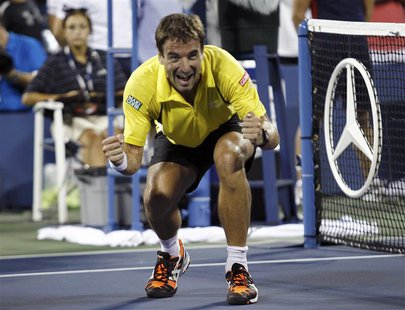 Tommy Robredo of Spain celebrates after defeating Roger Federer of Switzerland at the U.S. Open tennis championships in New York September 2