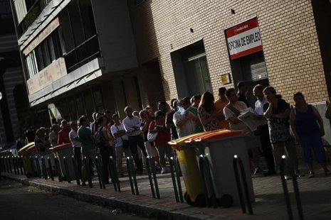 People wait to enter a government-run employment office in Madrid August 2, 2013.REUTERS/Susana Vera