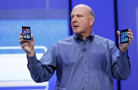 "Microsoft CEO Steve Ballmer displays Windows phones during his keynote address at the Microsoft ""Build"" conference in San Francisco, Califor"