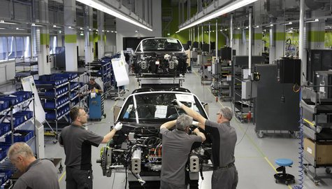 Electricians assemble a new Porsche 918-Spyder sports car at the production line of the German car manufacturer's plant in Stuttgart-Zuffenh