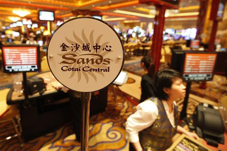 A logo of Sands Cotai Central is seen on a gaming table inside a casino on the opening day of the Sands Cotai Central, Sands' newest integra