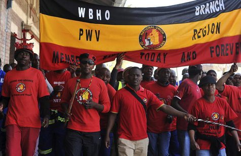 Members of the National Union of Mineworkers (NUM) take part in a strike in the central business district area of Johannesburg, August 27, 2