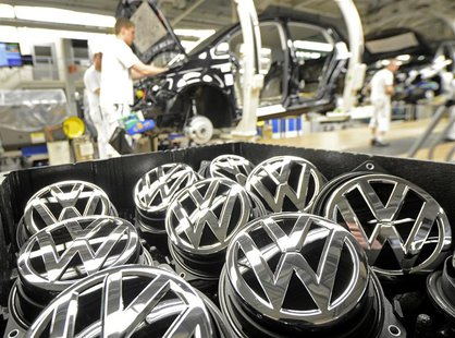 Emblems of VW Golf VII car are pictured in a production line at the plant of German carmaker Volkswagen in Wolfsburg, February 25, 2013. REU