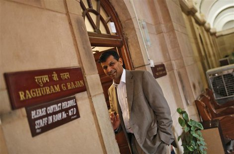 India's chief economic adviser Raghuram Rajan stands outside his room at the finance ministry in New Delhi August 6, 2013. REUTERS/Adnan Abi