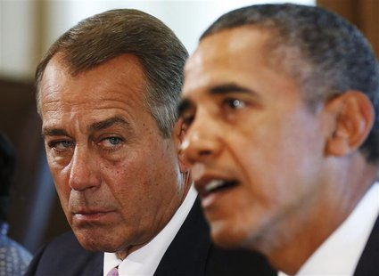 Speaker of the House John Boehner (R-OH) (L) listens to U.S. President Barack Obama during a meeting with bipartisan Congressional leaders i