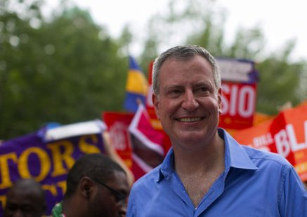 New York mayoral candidate Bill de Blasio participates in a march during the West Indian Day Parade in the Brooklyn borough of New York Sept
