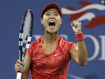 Li Na of China celebrates defeating Jelena Jankovic of Serbia at the U.S. Open tennis championships in New York September 1, 2013. REUTERS/A