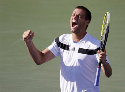 Mikhail Youzhny of Russia celebrates his victory over Lleyton Hewitt of Australia at the U.S. Open tennis championships in New York Septembe