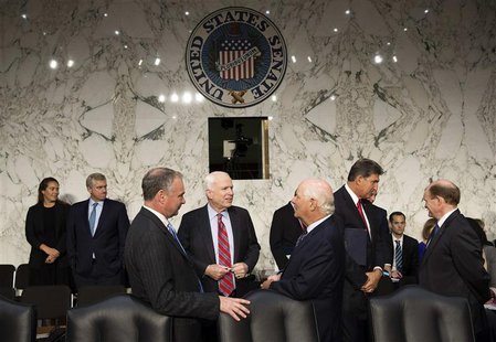 Senators John McCain (R-AZ) (center), Tim Kaine (D-VA) and Ben Cardin (D-MD) (right) speak before Chairman of the Joint Chiefs General Marti