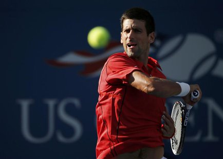 Novak Djokovic of Serbia hits a return to Marcel Granollers of Spain at the U.S. Open tennis championships in New York September 3, 2013. RE