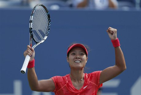 Li Na of China celebrates after defeating Ekaterina Makarova of Russia at the U.S. Open tennis championships in New York September 3, 2013.