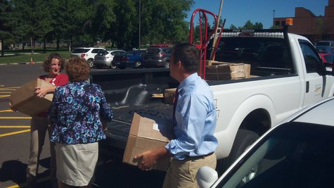 Congressman Sean Duffy helps to unload books for the Jim Dan Hill Library at UWS