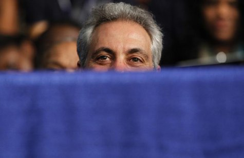 Chicago Mayor Rahm Emanuel listens as U.S. President Barack Obama speaks about strengthening the economy for the middle class and measures t