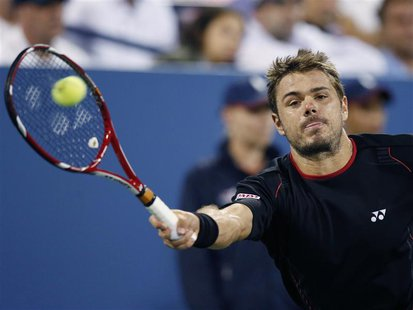 Stanislas Wawrinka of Switzerland reaches for a forehand to Tomas Berdych of the Czech Republic at the U.S. Open tennis championships in New