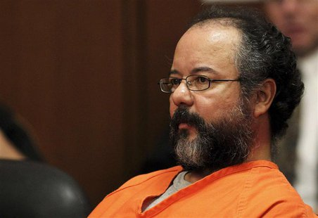 Ariel Castro, 53, sits in the courtroom during his sentencing for kidnapping, rape and murder in Cleveland, Ohio in this August 1, 2013 file