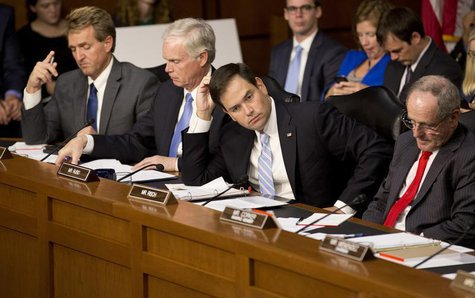(L-R) Senators Jeff Flake (R-AZ), Ron Johnson (R-WI), Marco Rubio (R-FL) and James Risch (R-ID) listen as (not pictured) U.S. Defense Secret
