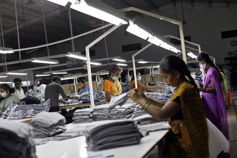 Employees sort clothes before packing them at the Estee garment factory in Tirupur, in the southern Indian state of Tamil Nadu June 19, 2013