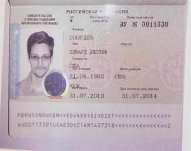 Fugitive former U.S. spy agency contractor Edward Snowden's new refugee documents granted by Russia is seen during a news conference in Mosc