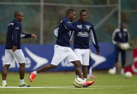 Ecuador's soccer players (L-R) Oscar Bagui, Edison Mendez and Renato Ibarra train during a practice session at the national soccer team's he
