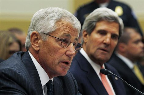 U.S. Secretary of Defense Chuck Hagel (L) testifies alongside Secretary of State John Kerry at a U.S. House Foreign Affairs Committee hearin
