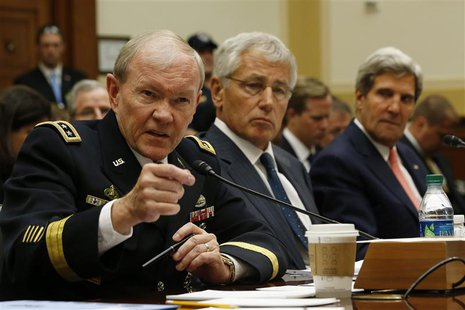 (L-R) U.S. General Martin Dempsey, chairman of the Joint Chiefs of Staff, U.S. Secretary of Defense Chuck Hagel and U.S. Secretary of State