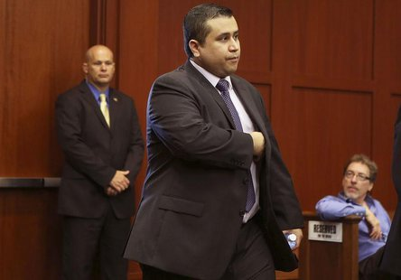 George Zimmerman enters the courtroom for his trial in Sanford, Florida July 13, 2013 during the trial of George Zimmerman in the shooting d